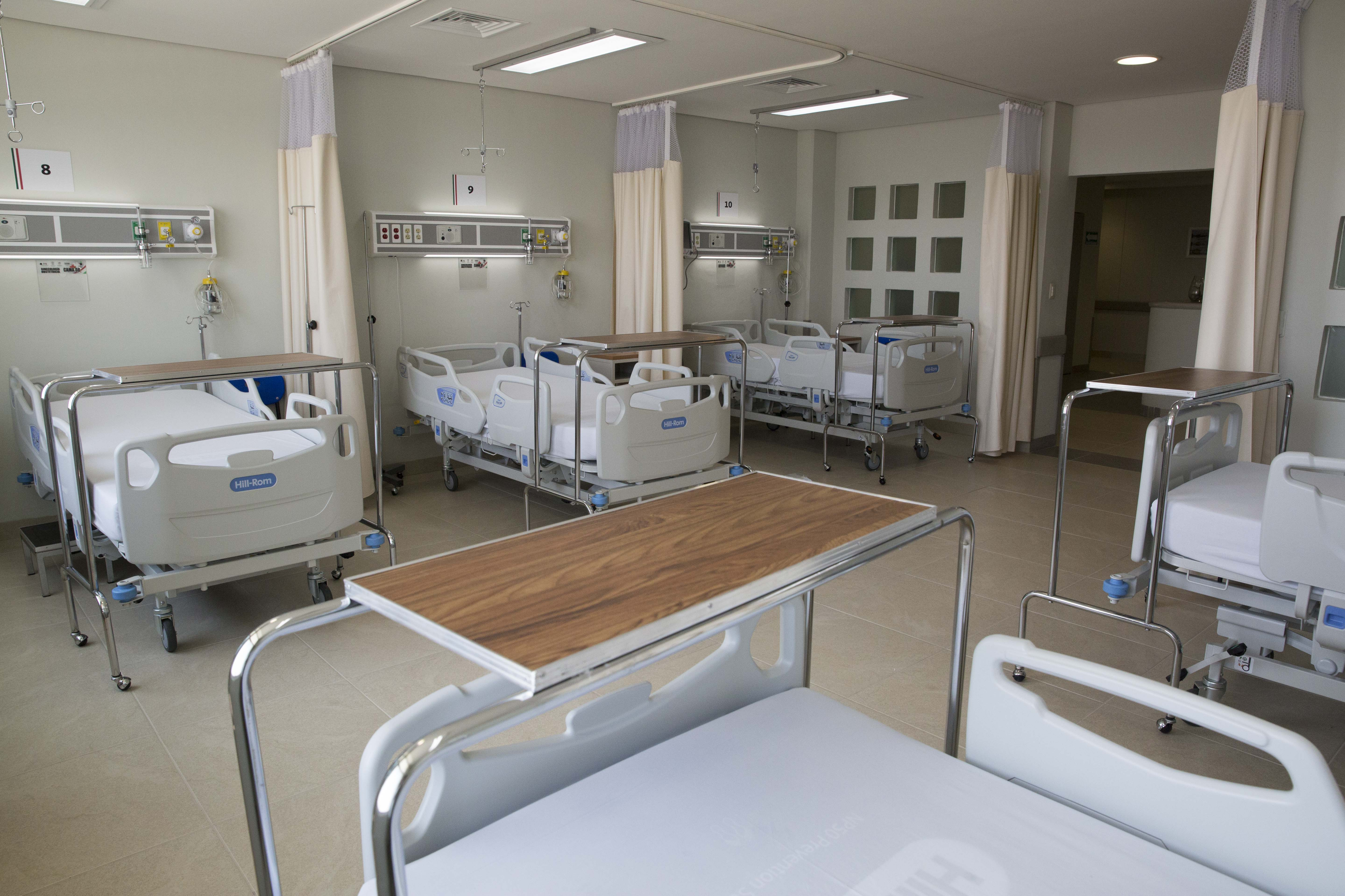 Hospital wing with several beds and equipment
